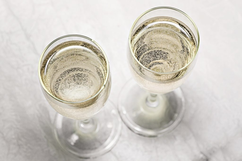 two glasses of champagne in a close-up top view.